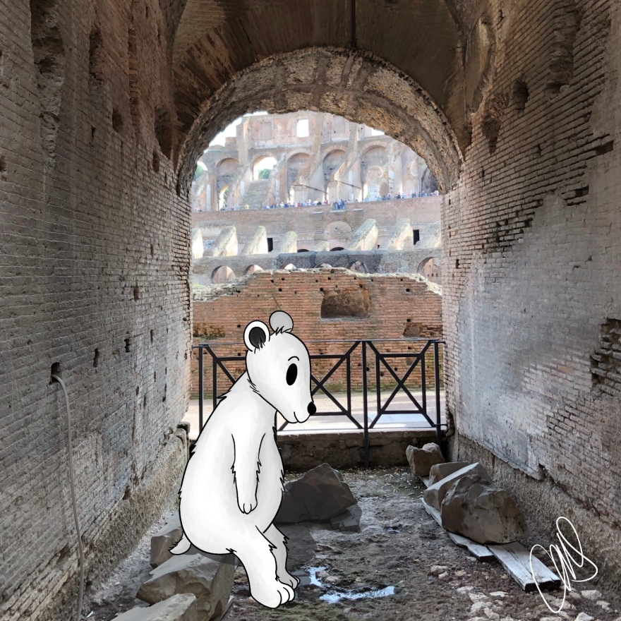 Photographed in the Colosseum in Rome at ground level looking out into the center. Sitting on some stones in the ruins is an illustrated polar bear looking down at the ground.